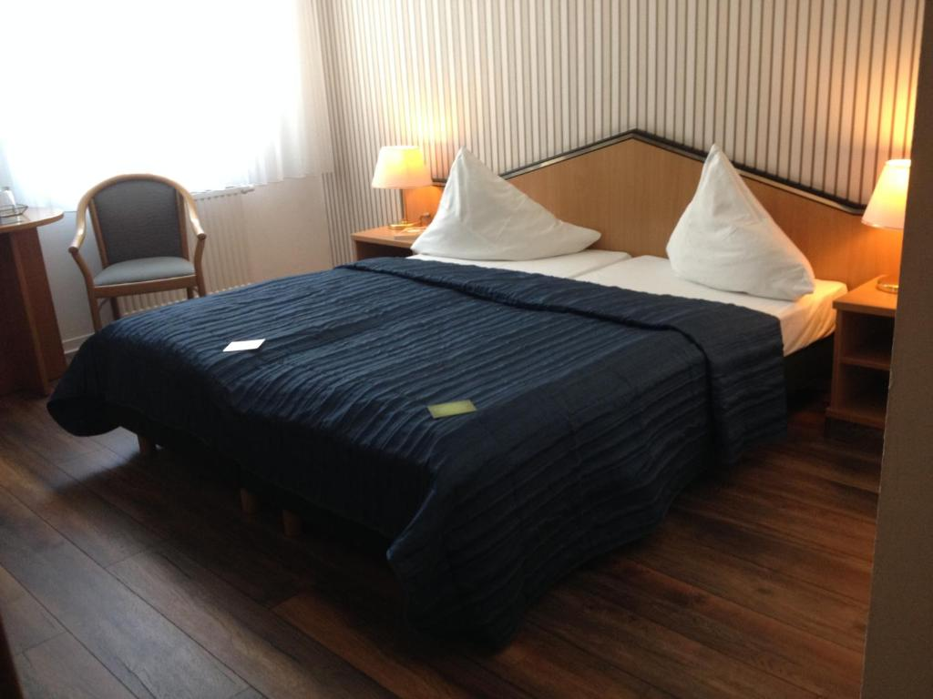 Ein Bett oder Betten in einem Zimmer der Unterkunft Residenz Hotel Leipzig