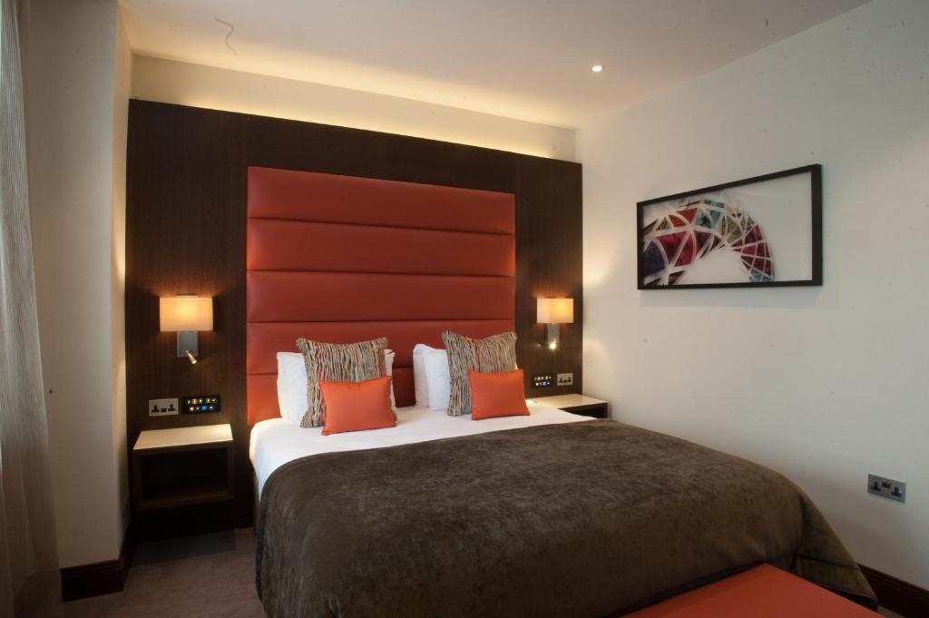 Un ou plusieurs lits dans un hébergement de l'établissement St George's Hotel - Wembley