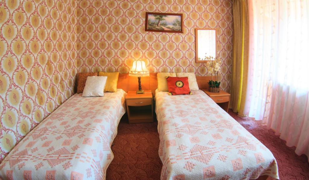 A bed or beds in a room at Zvenigorodsky Resort
