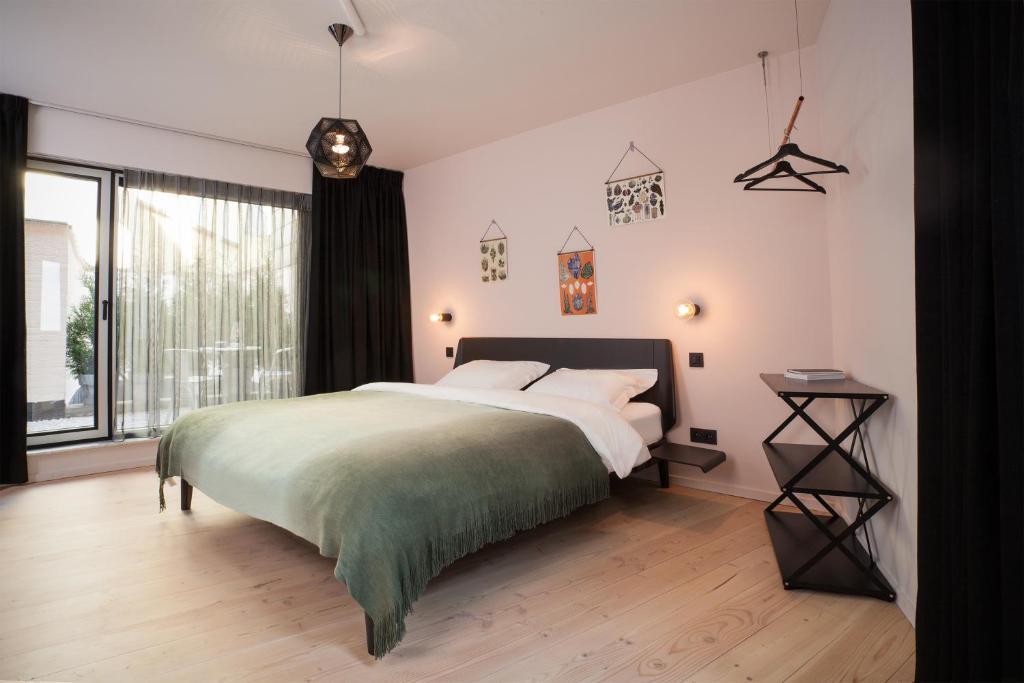 A bed or beds in a room at B&B Lucy in the Sky