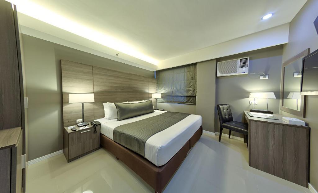 Cama o camas de una habitación en Astoria Greenbelt