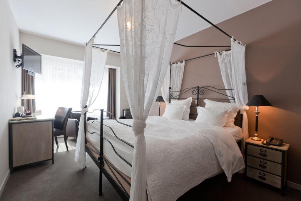 Un ou plusieurs lits dans un hébergement de l'établissement Hotel De Hofkamers