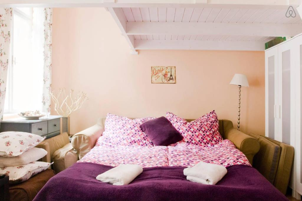 A bed or beds in a room at Adorable Budapest