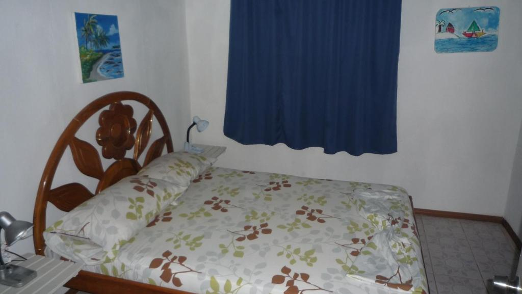 A bed or beds in a room at Katty´s Paradise