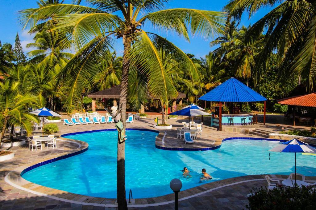 A piscina localizada em Orange Praia Hotel ou nos arredores