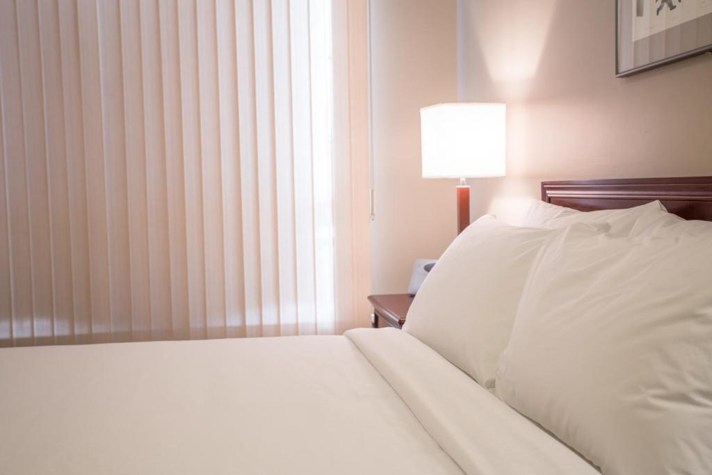 A bed or beds in a room at Capital Suites Iqaluit
