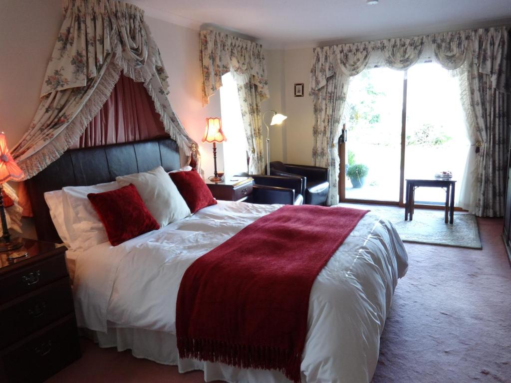 A bed or beds in a room at Tigh Na Bruach B&B