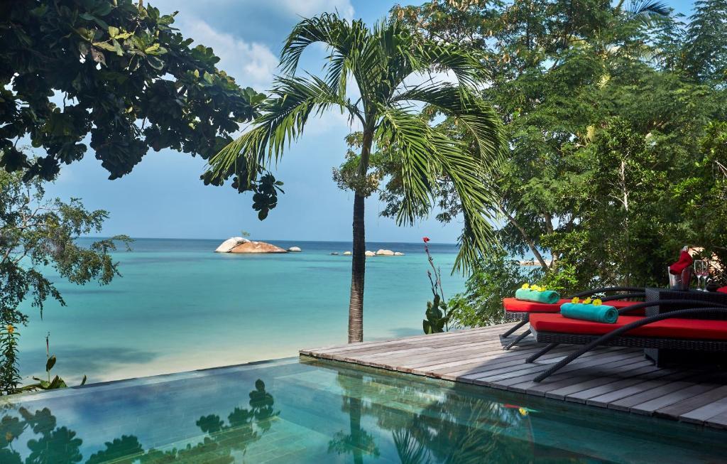 The swimming pool at or near Kupu Kupu Phangan Beach Villas & Spa by L'Occitane