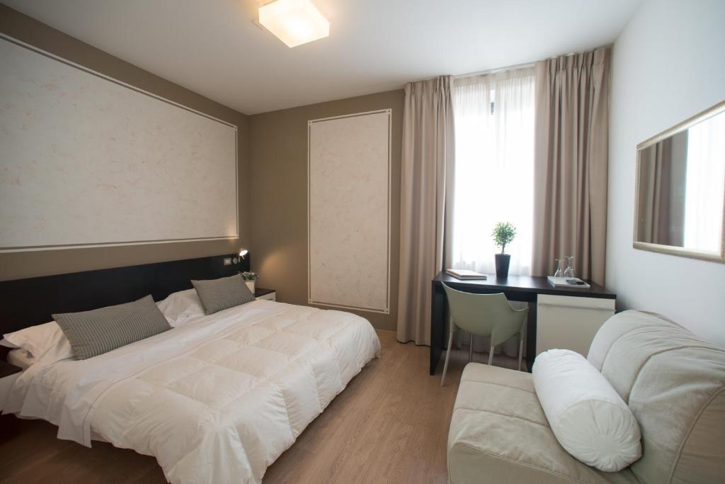Кровать или кровати в номере Berghotel