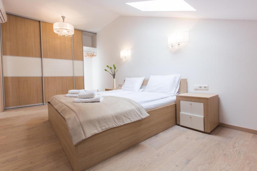 Lova arba lovos apgyvendinimo įstaigoje Katrin Apartments