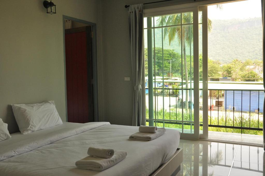 A bed or beds in a room at Khaoyai Terrazzo
