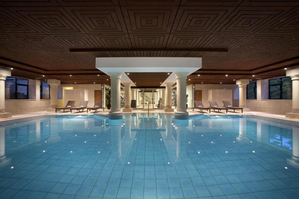 The swimming pool at or near Hilton Royal Parc Soestduinen