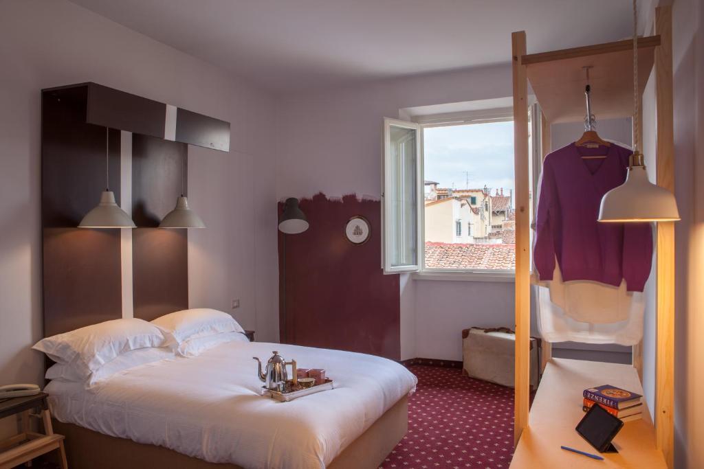 Katil atau katil-katil dalam bilik di Florence Dome Hotel