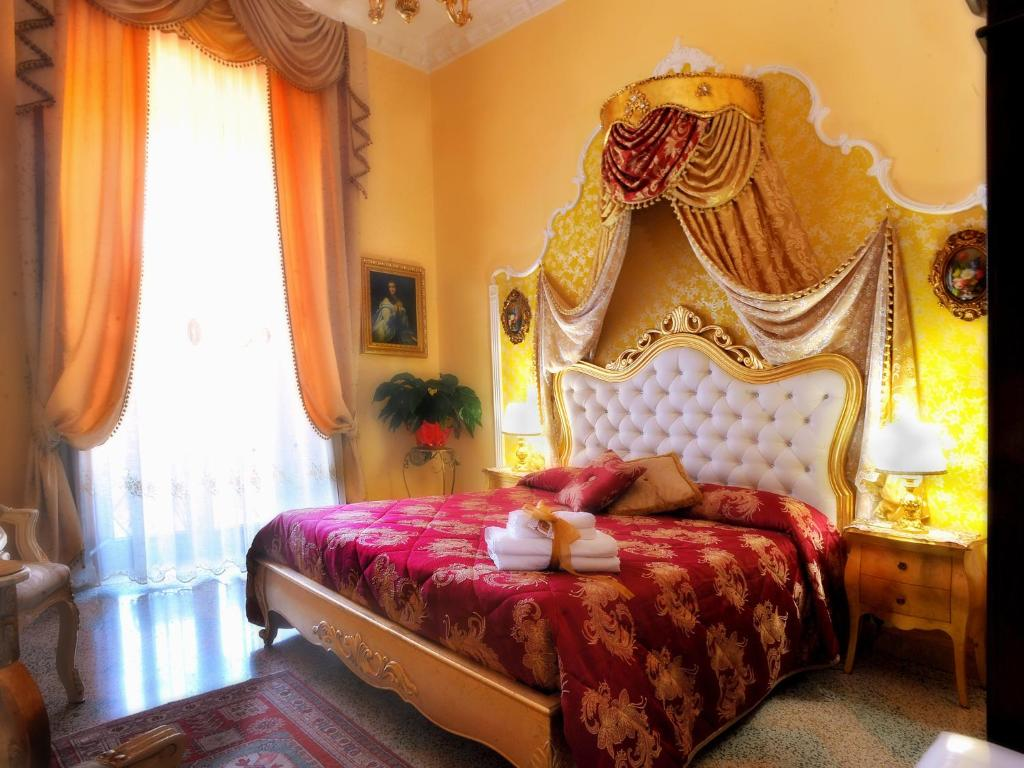 Letto o letti in una camera di B&B La Dolce Vita - Luxury House