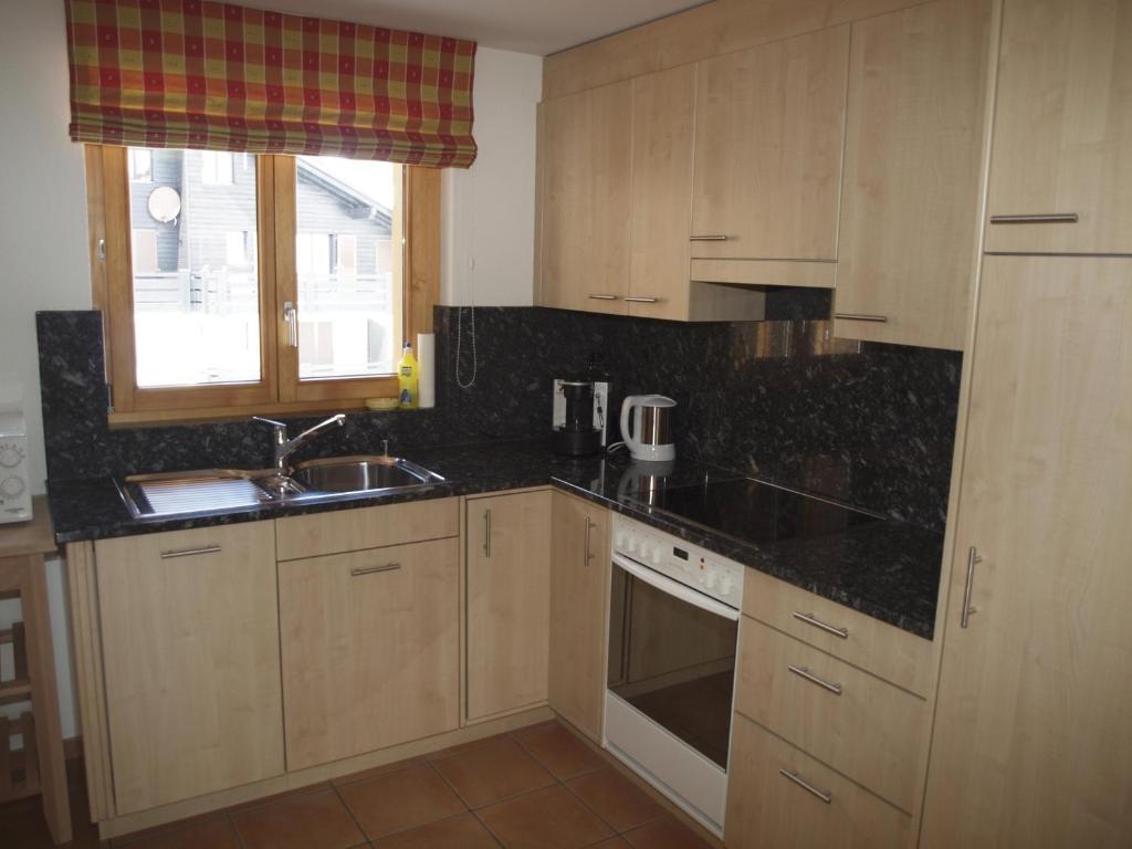 A kitchen or kitchenette at Haus Alparosa Wohnung Degen