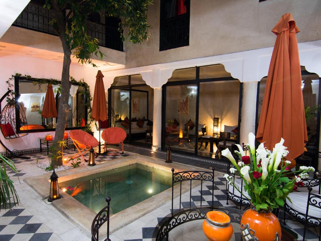 The swimming pool at or near Riad Le Bel Oranger