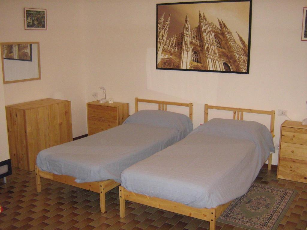 A bed or beds in a room at Flat in Milan 3