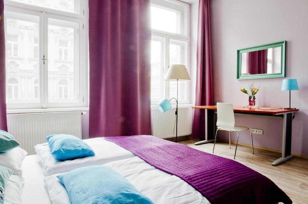 Cama o camas de una habitación en Royal Court Legerova