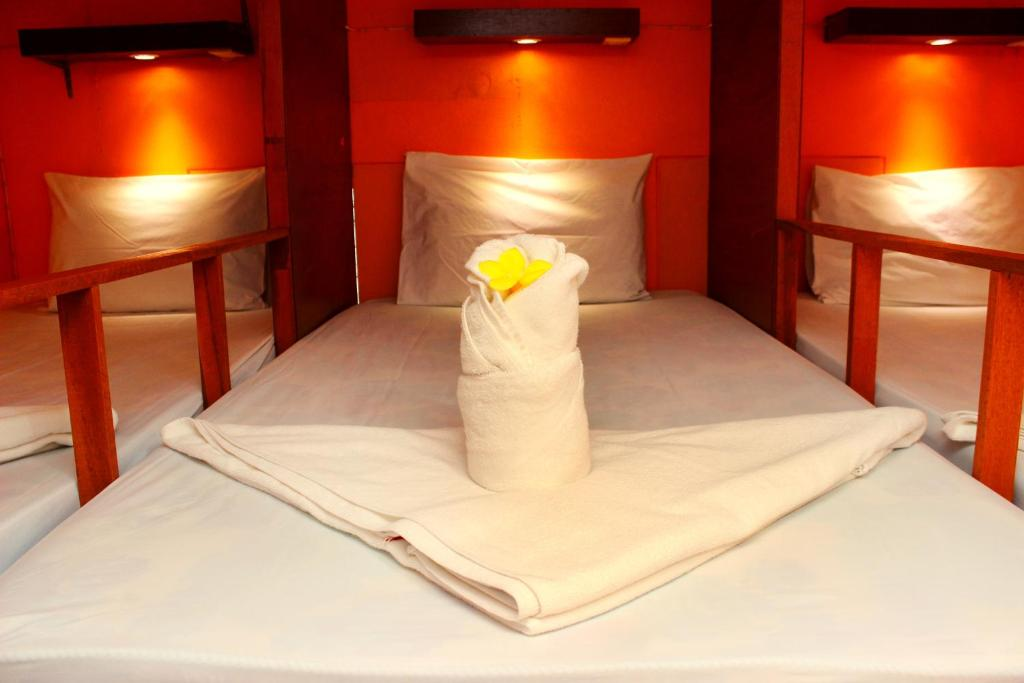Un ou plusieurs lits dans un hébergement de l'établissement Yoghurt Home Hostel