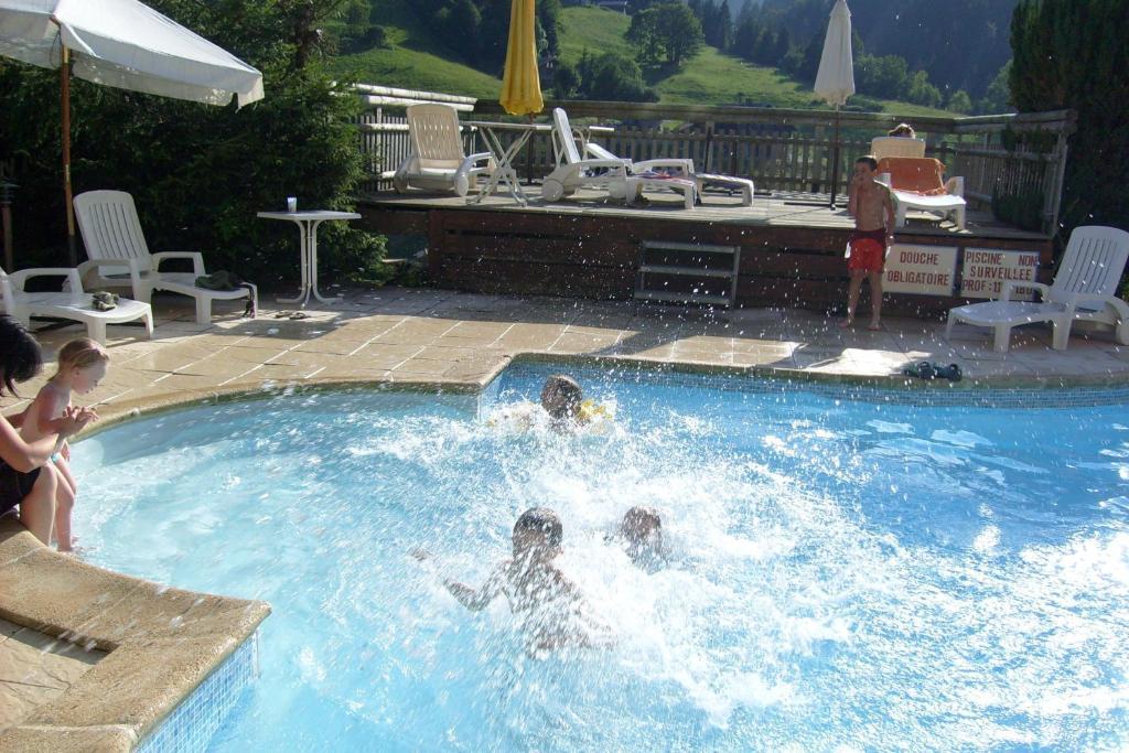 The swimming pool at or near Chalet-Hôtel du Borderan
