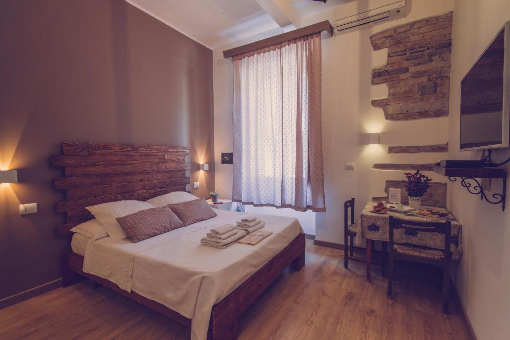 A bed or beds in a room at La Casa del Cuore