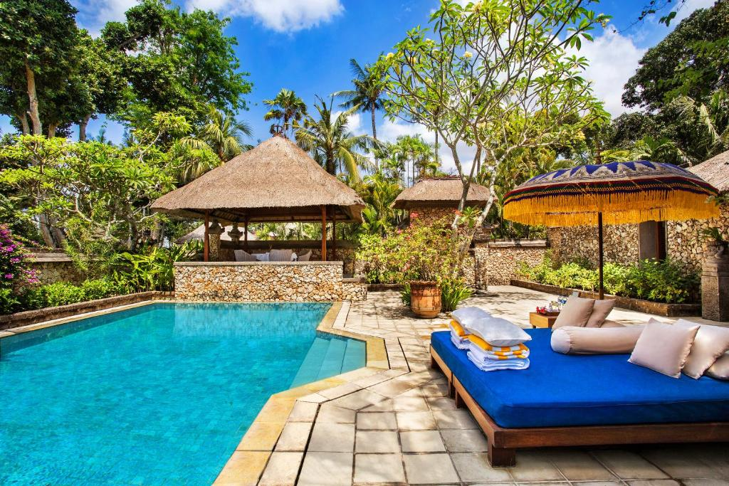 The swimming pool at or near The Oberoi Beach Resort, Bali