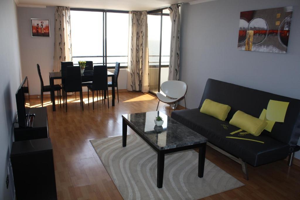 Coin salon dans l'établissement Arrecife Costanera Sur Apartments