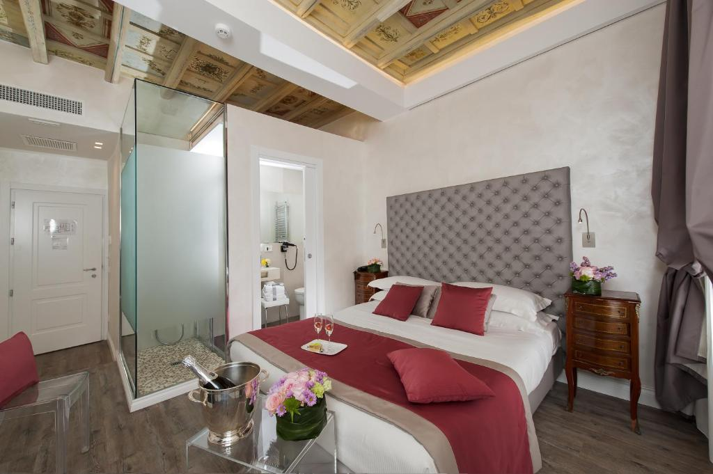 Een bed of bedden in een kamer bij Hotel Navona