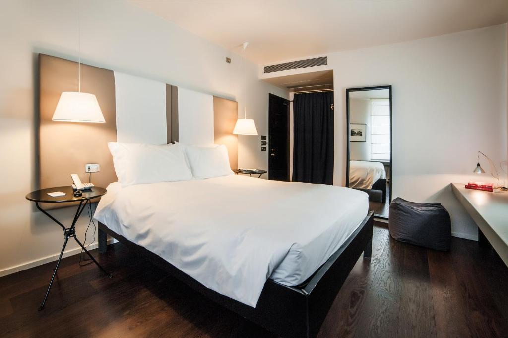 מיטה או מיטות בחדר ב-Hotel Casa Poli
