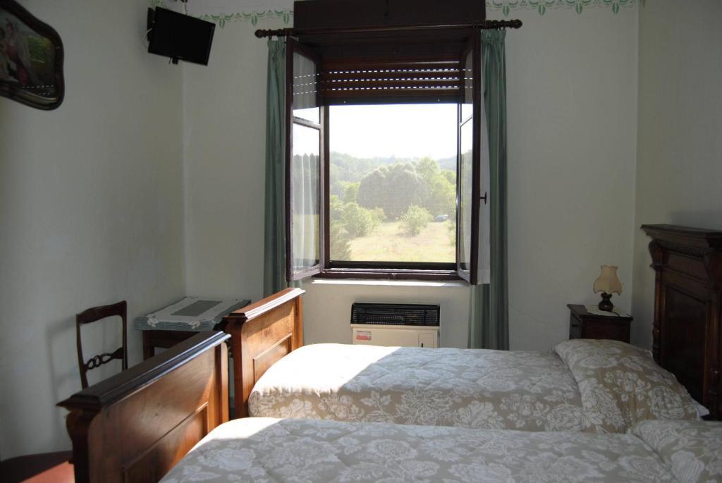Ein Bett oder Betten in einem Zimmer der Unterkunft B&B La Cà Cita