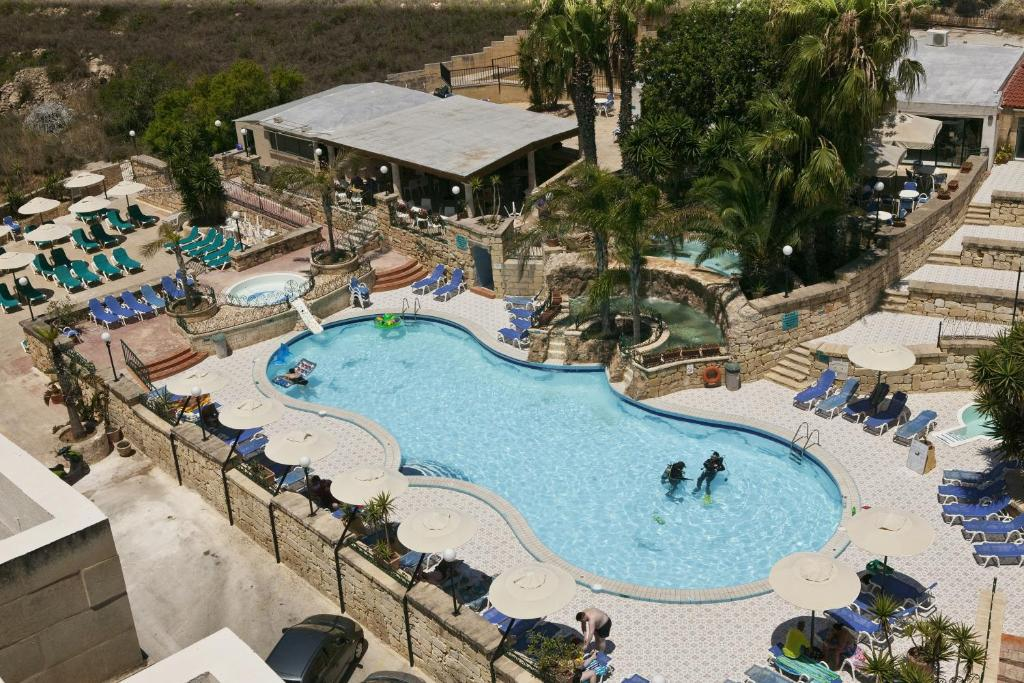 A view of the pool at Porto Azzurro Aparthotel or nearby