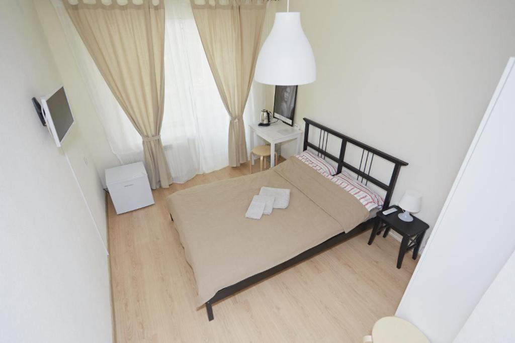 A bed or beds in a room at Zona Sna na Studencheskoy