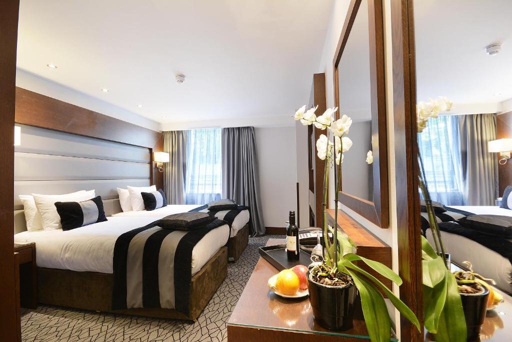 Letto o letti in una camera di Park Grand Paddington Court