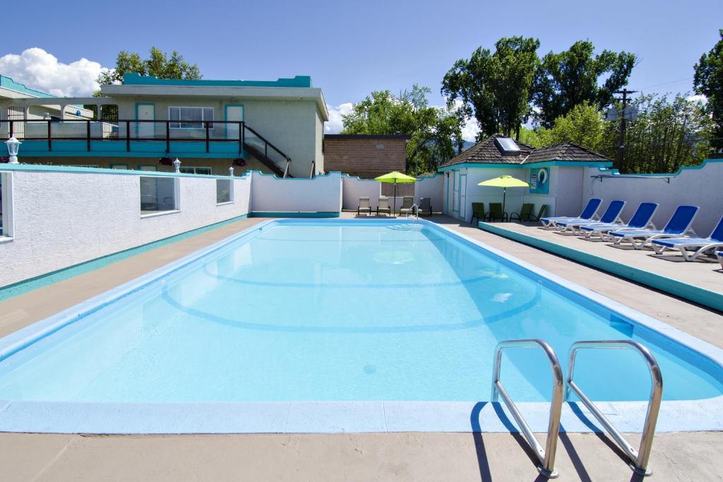 The swimming pool at or near Tiki Shores Condominium Beach Resort