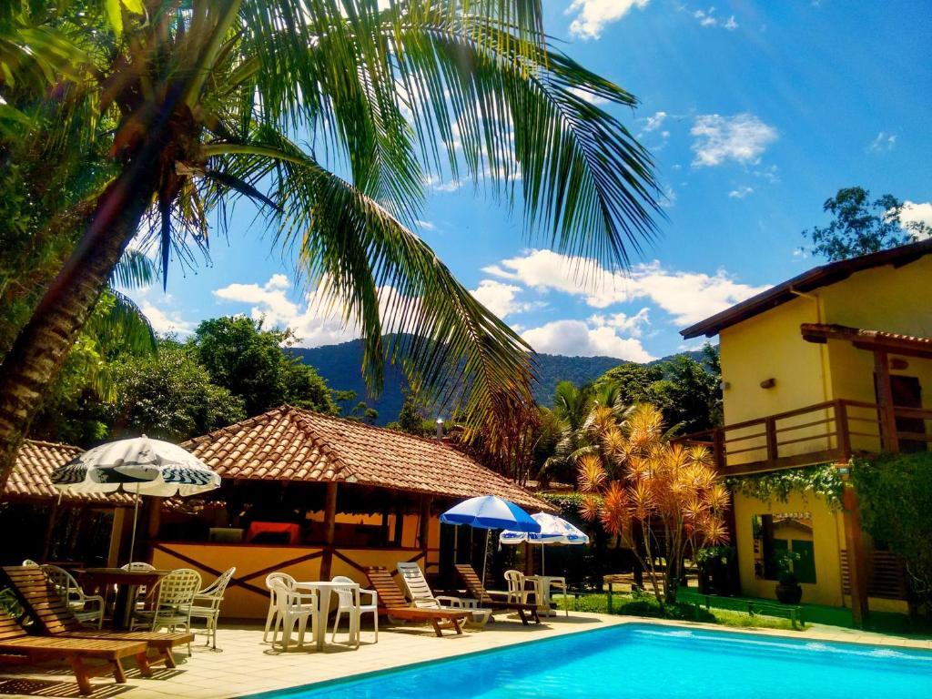 The swimming pool at or near Hotel e Pousada Canto Mágico