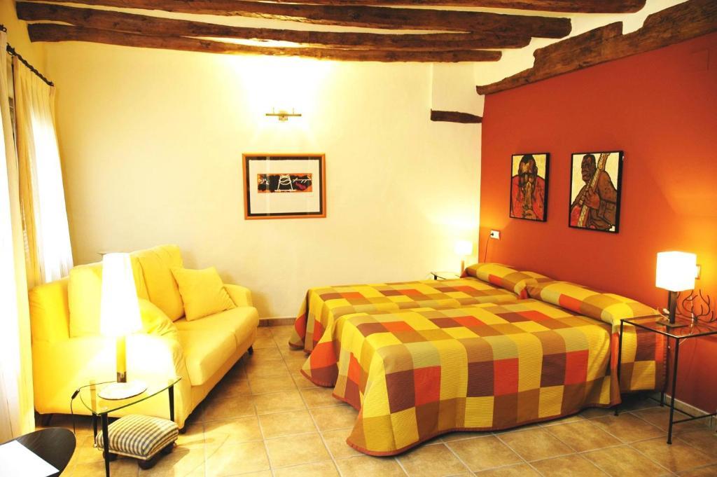 Cama o camas de una habitación en La Posada de Berge