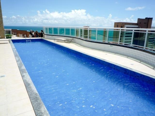 The swimming pool at or near Studio Iracema