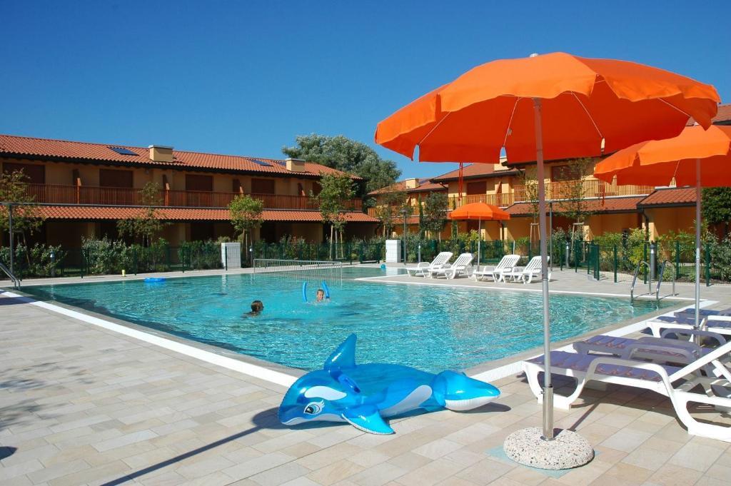The swimming pool at or near Villaggio Tamerici
