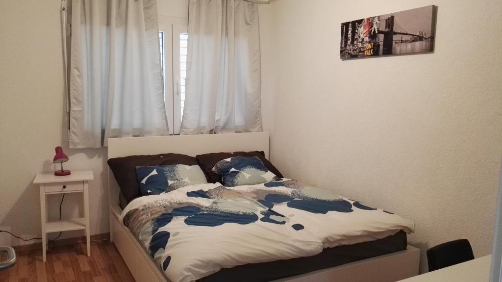 Ein Bett oder Betten in einem Zimmer der Unterkunft Ulysse B&B