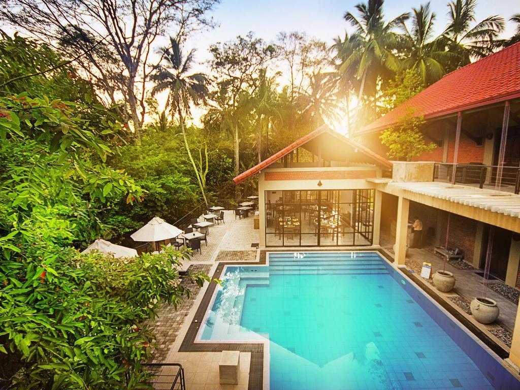 The swimming pool at or near Arika Villa