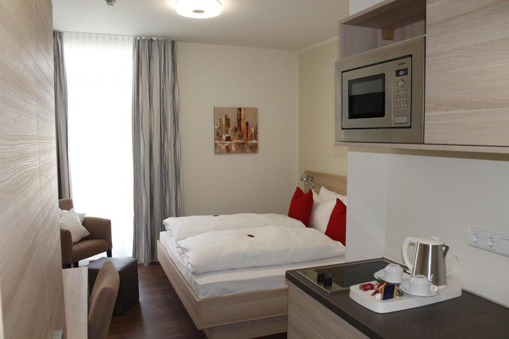 A bed or beds in a room at Prime 20 Serviced Apartments