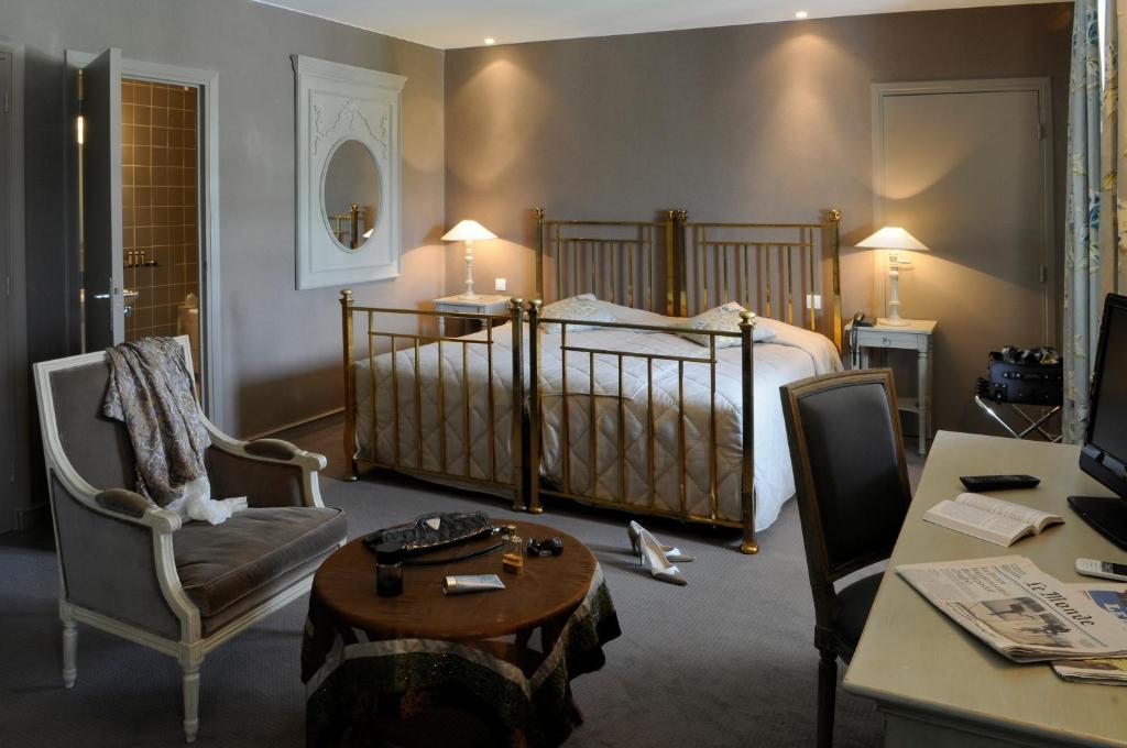 Un ou plusieurs lits dans un hébergement de l'établissement Splendid Hotel by Popinns