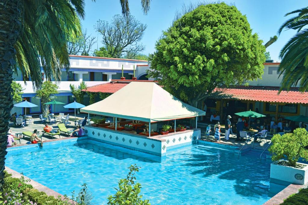 The swimming pool at or near Villas Teotihuacan Hotel & Spa