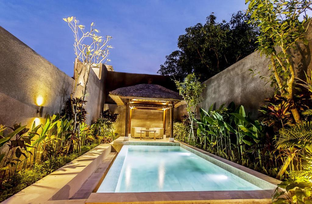 The swimming pool at or near Sri Abi Ratu Villa