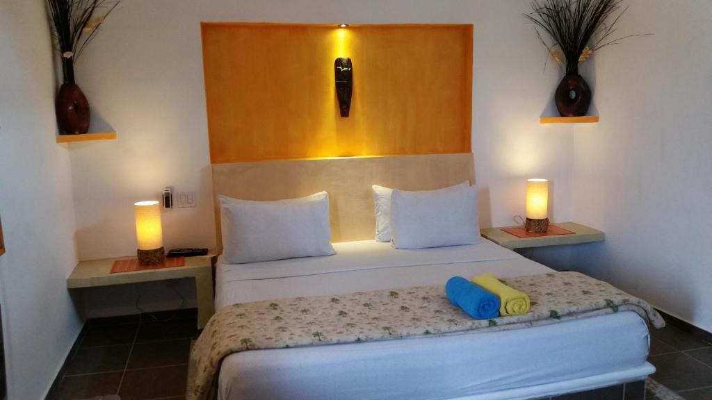 Cama o camas de una habitación en Casita de Maya Boutique Hotel