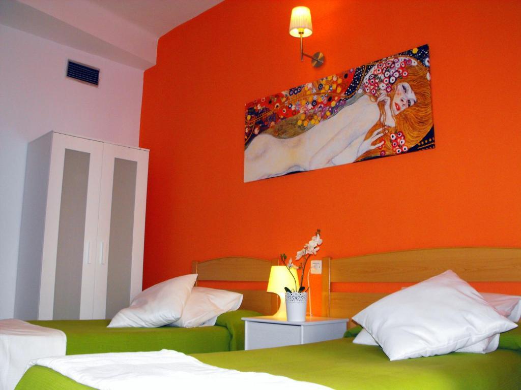 Lova arba lovos apgyvendinimo įstaigoje Hostal Santa Catalina