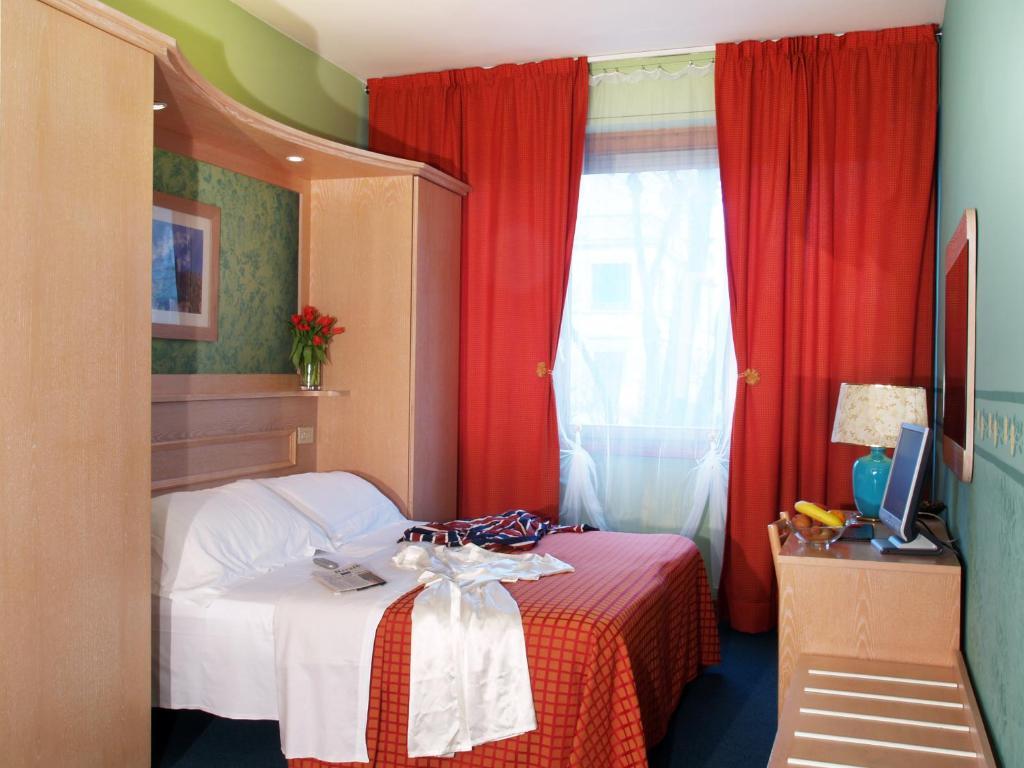 Ein Bett oder Betten in einem Zimmer der Unterkunft Hotel Meridiana