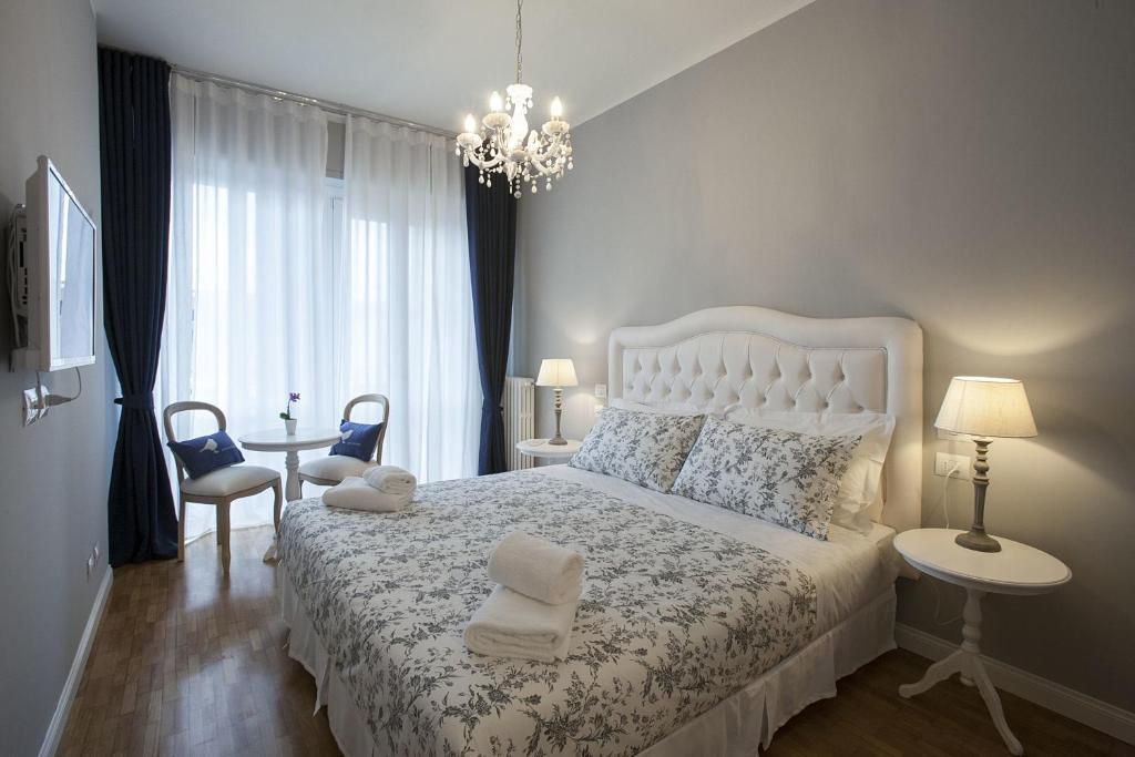 A bed or beds in a room at B&B La Nannina