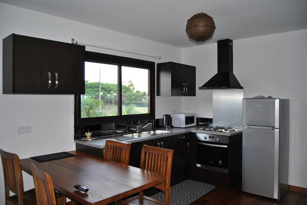 Cuisine ou kitchenette dans l'établissement Karenga Appartel