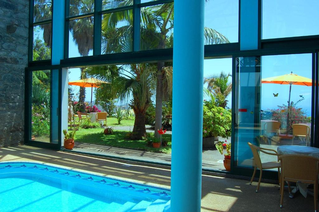 The swimming pool at or near Vila Afonso